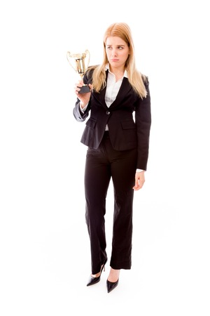 Disappointed businesswoman holding a golden trophy photo