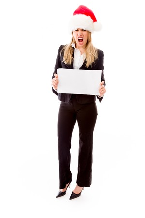 Businesswoman holding a blank placard and shouting in frustration photo