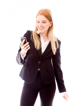 Businesswoman reading message on mobile phone photo