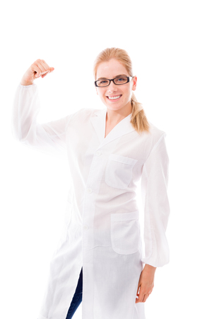 Female scientist standing and flexing biceps