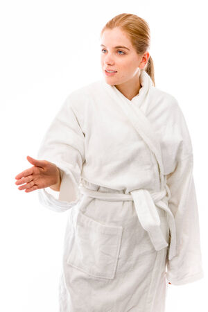 Young woman standing in bathrobe and offering hand for handshake photo