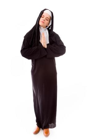nun: Young nun in prayer position