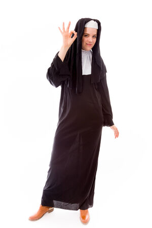 Young nun showing ok sign photo