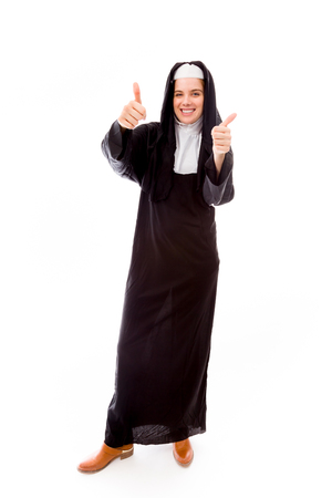 Young nun showing thumbs up sign from both hands photo
