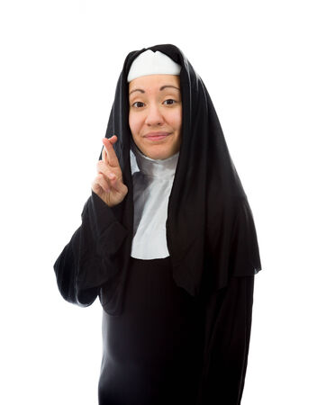 crossing fingers: Young nun wishing with crossing fingers