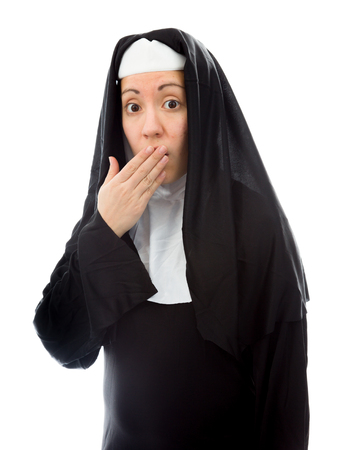 Young nun with hand over her mouth and shock photo