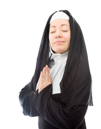 religious clothing: Young nun in prayer position