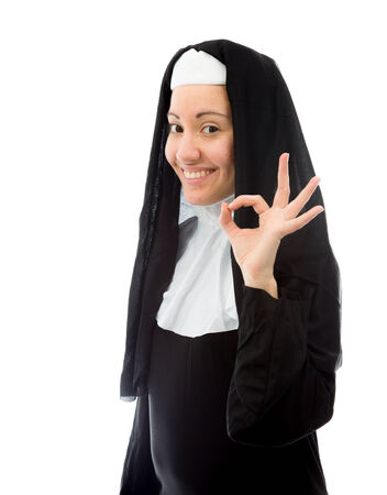 Young nun showing ok sign and smiling photo
