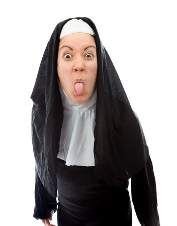 religious clothing: Young woman sticking her tongue out