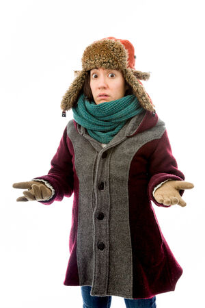 Young woman shrugging in warm clothing photo