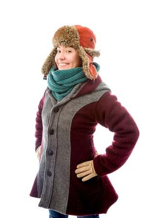 arms akimbo: Young woman in warm clothing and standing with her arms akimbo