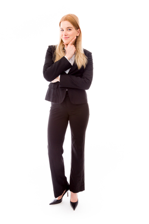 Businesswoman standing with hand on chin photo