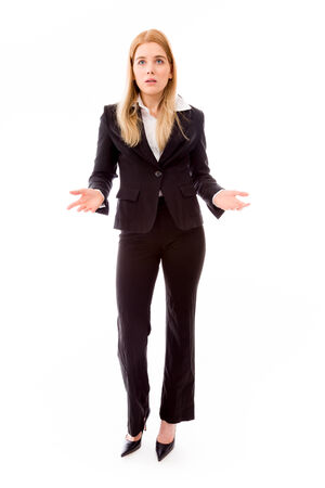 Businesswoman holding out both hands looking puzzled photo
