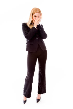Businesswoman peeking through fingers Imagens