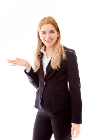 Businesswoman showing product with open hand palm photo