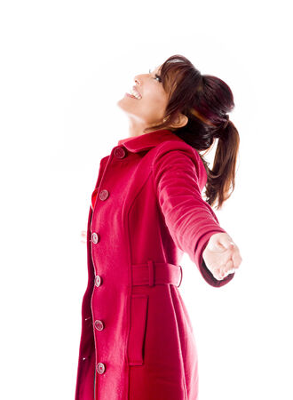 Side profile of an Indian young woman with arms outstretched and day dreaming