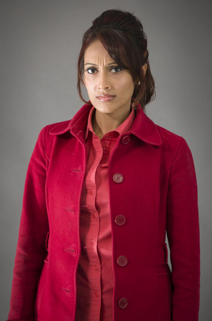 allegation: Portrait of a serious Indian young woman