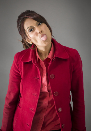 Indian young woman sticking out her tongue
