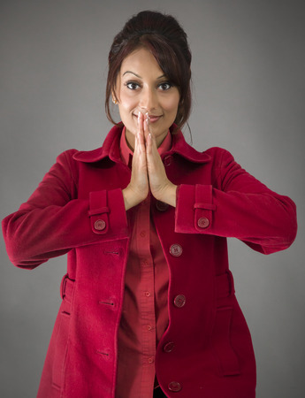 Indian young woman welcoming with hands joined photo