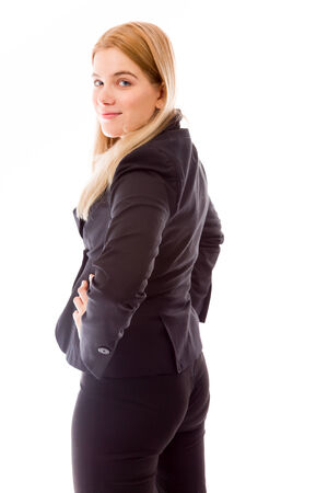 Rear view of a businesswoman standing with hand on waist photo