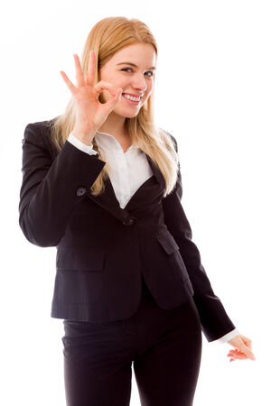 Portrait of a businesswoman gesturing OK photo