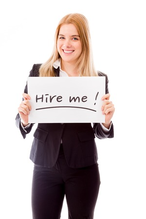 Businesswoman holding a message board with the text words Hire me photo
