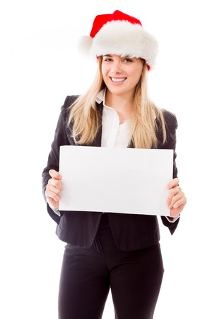 Portrait of a businesswoman holding a blank placard photo