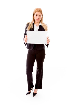 Disappointed businesswoman holding a blank placard photo