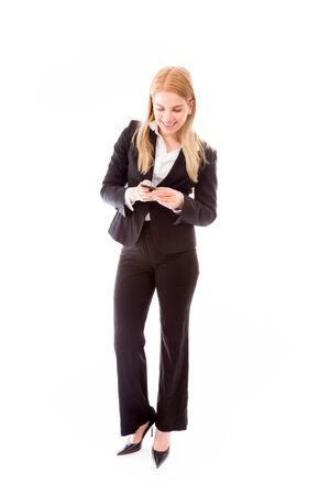 Businesswoman text messaging on a mobile phone Foto de archivo