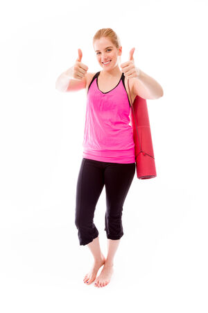 Young woman showing thumbs up towards camera with both hands photo