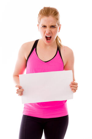 Frustrated young woman showing a blank placard photo
