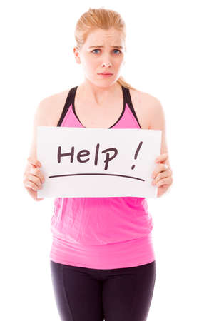 help: Young woman showing help sign on white background Stock Photo