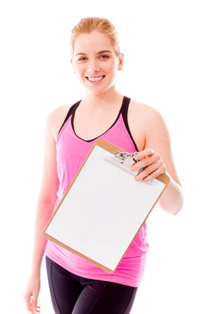 Young woman showing a blank clipboard photo