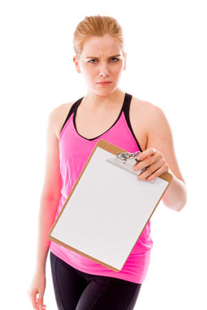 allegation: Young woman holding a clipboard and staring toward camera Stock Photo