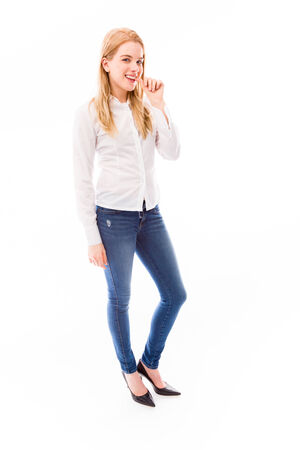 Young woman biting fingernails photo