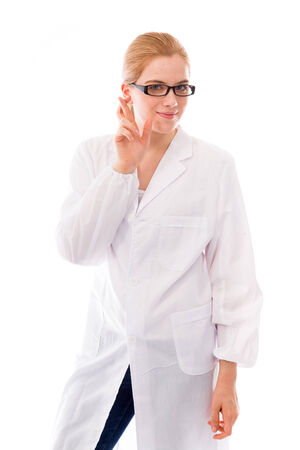 Female scientist standing with her fingers crossed photo