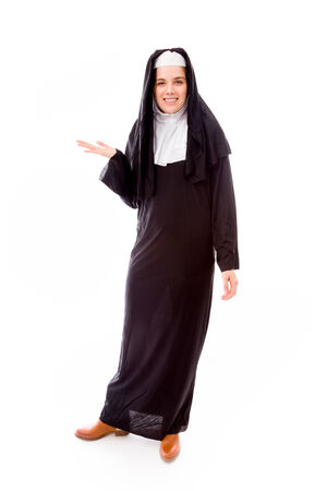 religious habit: Young nun showing something Stock Photo