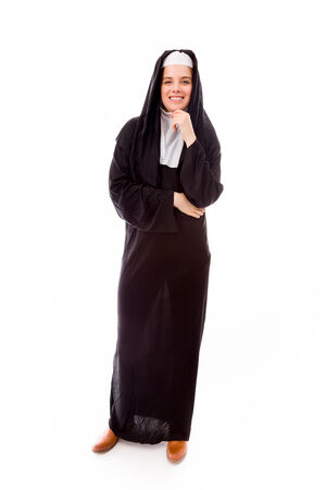 religious habit: Young woman smiling with her hand on chin Stock Photo