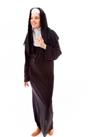 religious habit: Young nun smiling with pointing