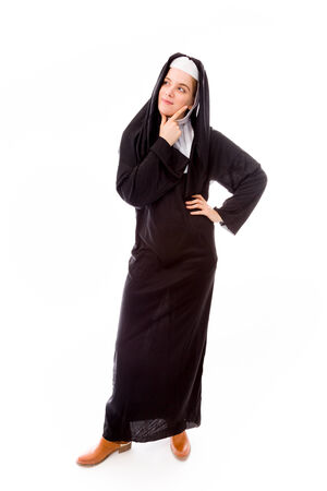 Young nun thinking with her hand on chin