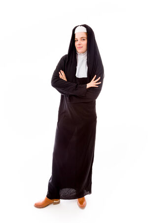 religious habit: Young nun standing with her arms crossed Stock Photo