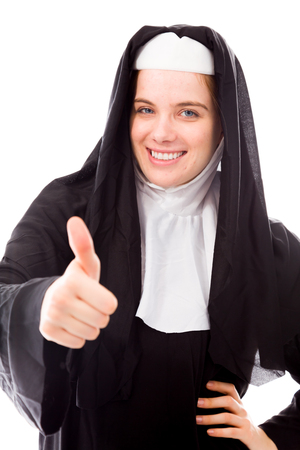 Young nun showing thumbs up sign and smiling Stock Photo - 29475438