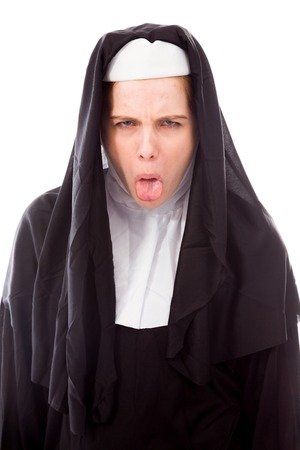 Young nun sticking out her tongue photo