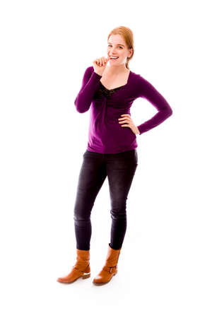 Young woman biting nail and smiling photo