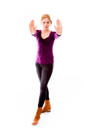 Young woman making stop gesture sign from both hands photo