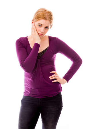 Young woman looking sad with her hand on chin photo