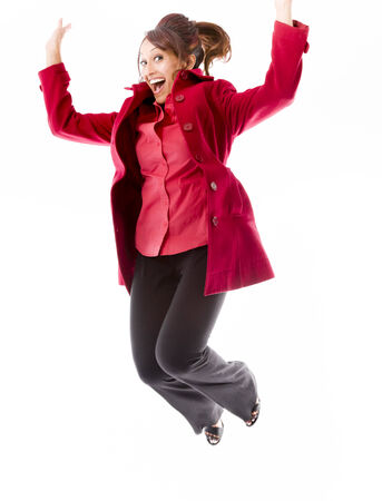 Indian young woman jumping in air and laughing