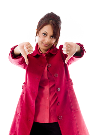 Indian young woman showing thumbs down sign from both hands Stock Photo