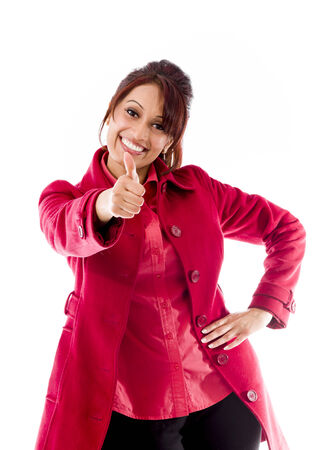 Smiling Indian young Woman showing thumb up sign isolated on white background photo