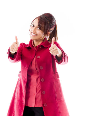 only adult: Smiling Indian young Woman showing thumb up sign isolated on white background Stock Photo
